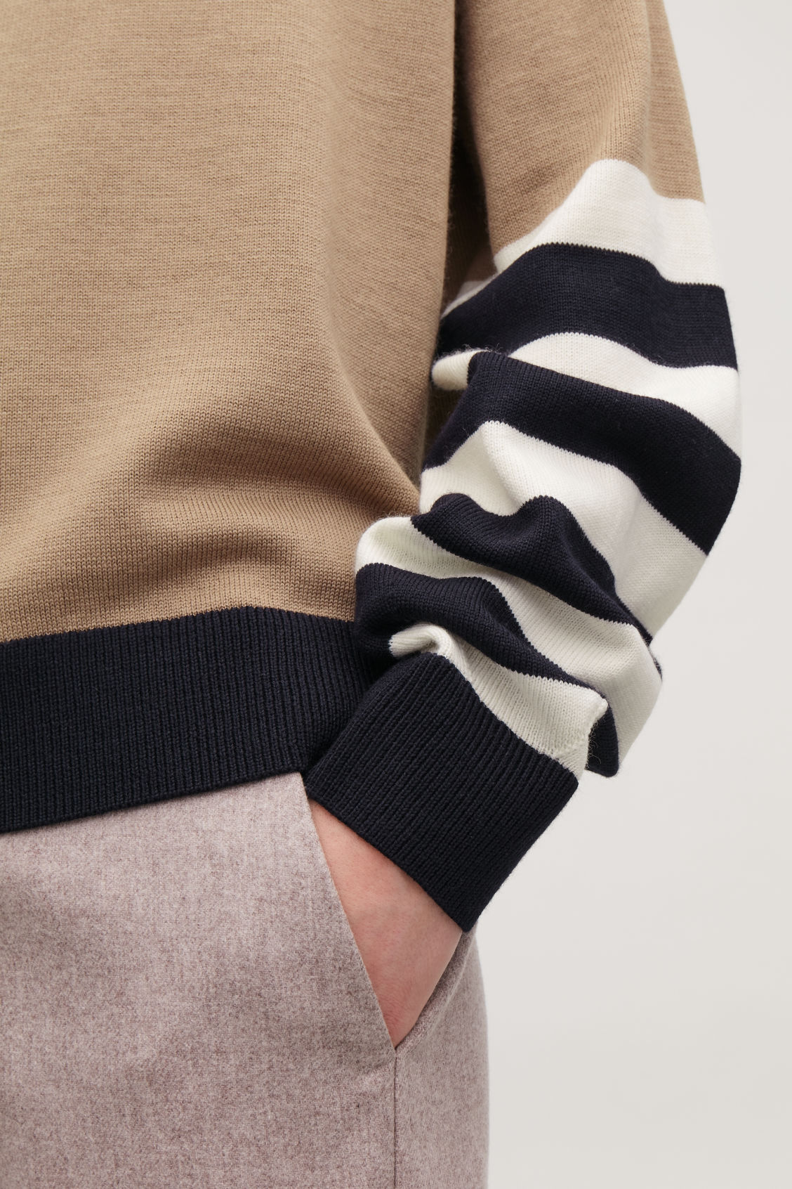 Model side image of Cos colour-block wool jumper in beige