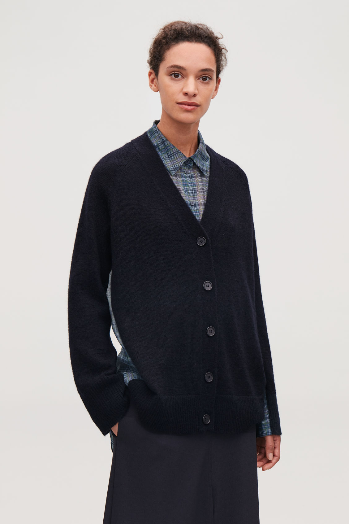 Model side image of Cos woven-knit mix cardigan in blue