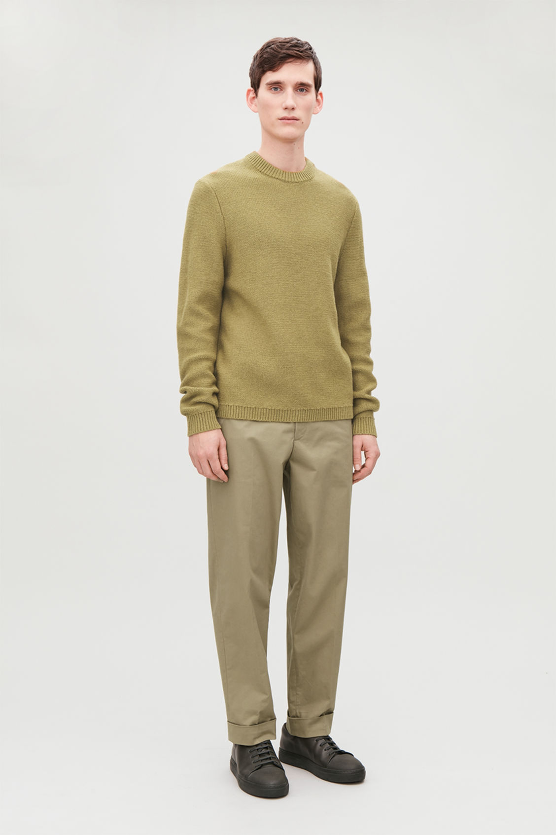Model front image of Cos cotton press-folds chinos in beige