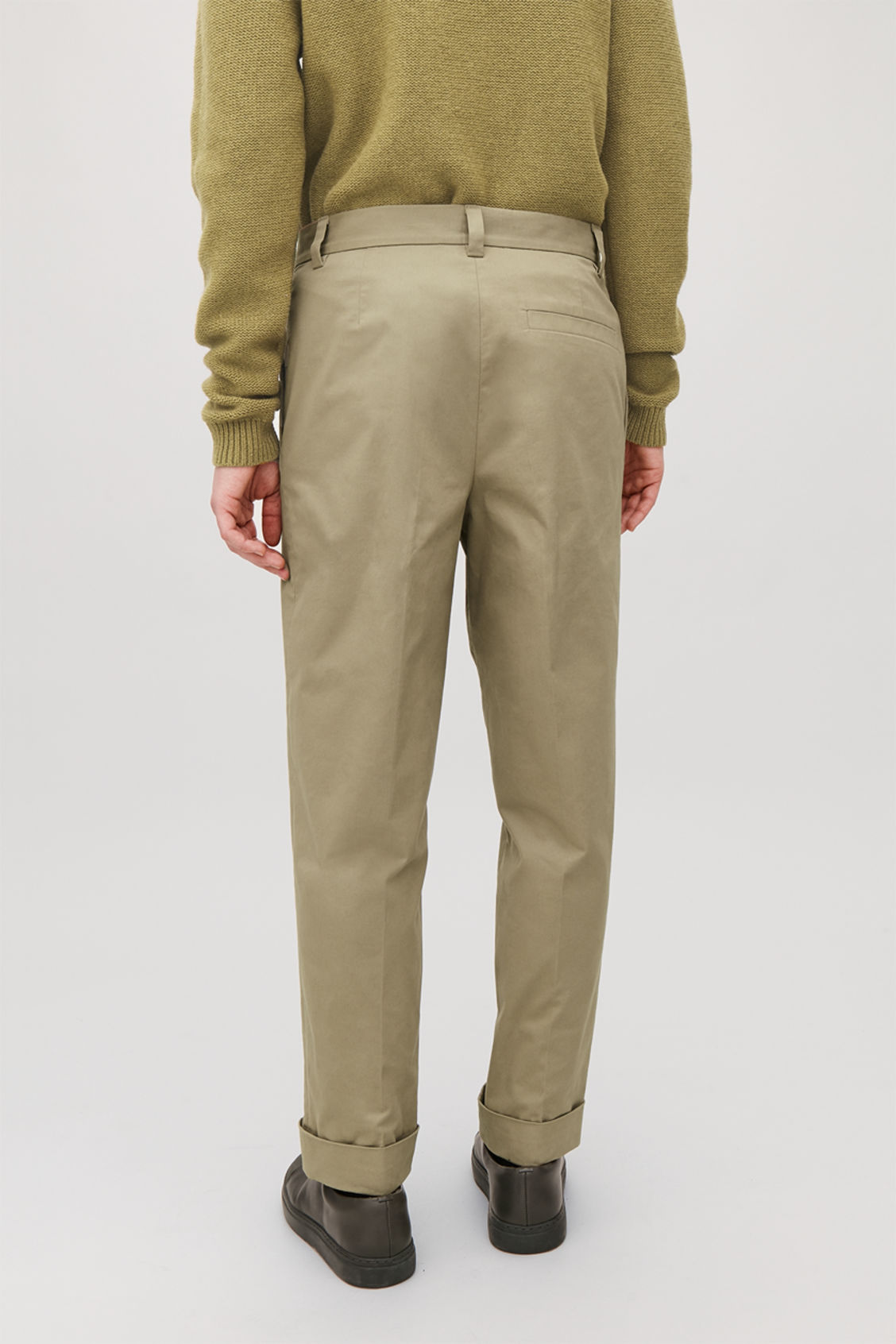 Model side image of Cos cotton press-folds chinos in beige