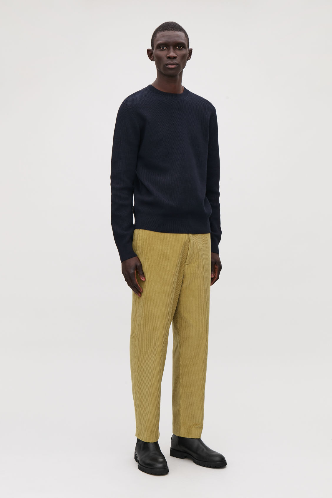 Model front image of Cos cropped corduroy trousers in yellow
