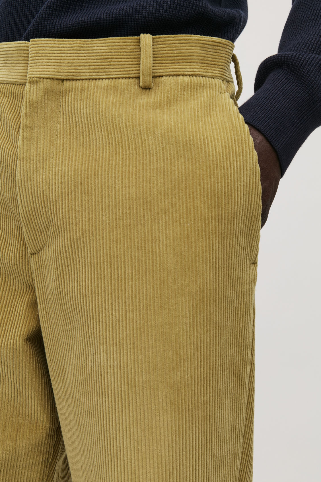 Model side image of Cos cropped corduroy trousers in yellow