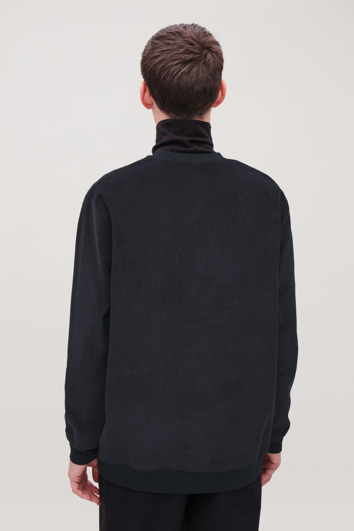 Model side image of Cos corduroy sweatshirt in blue