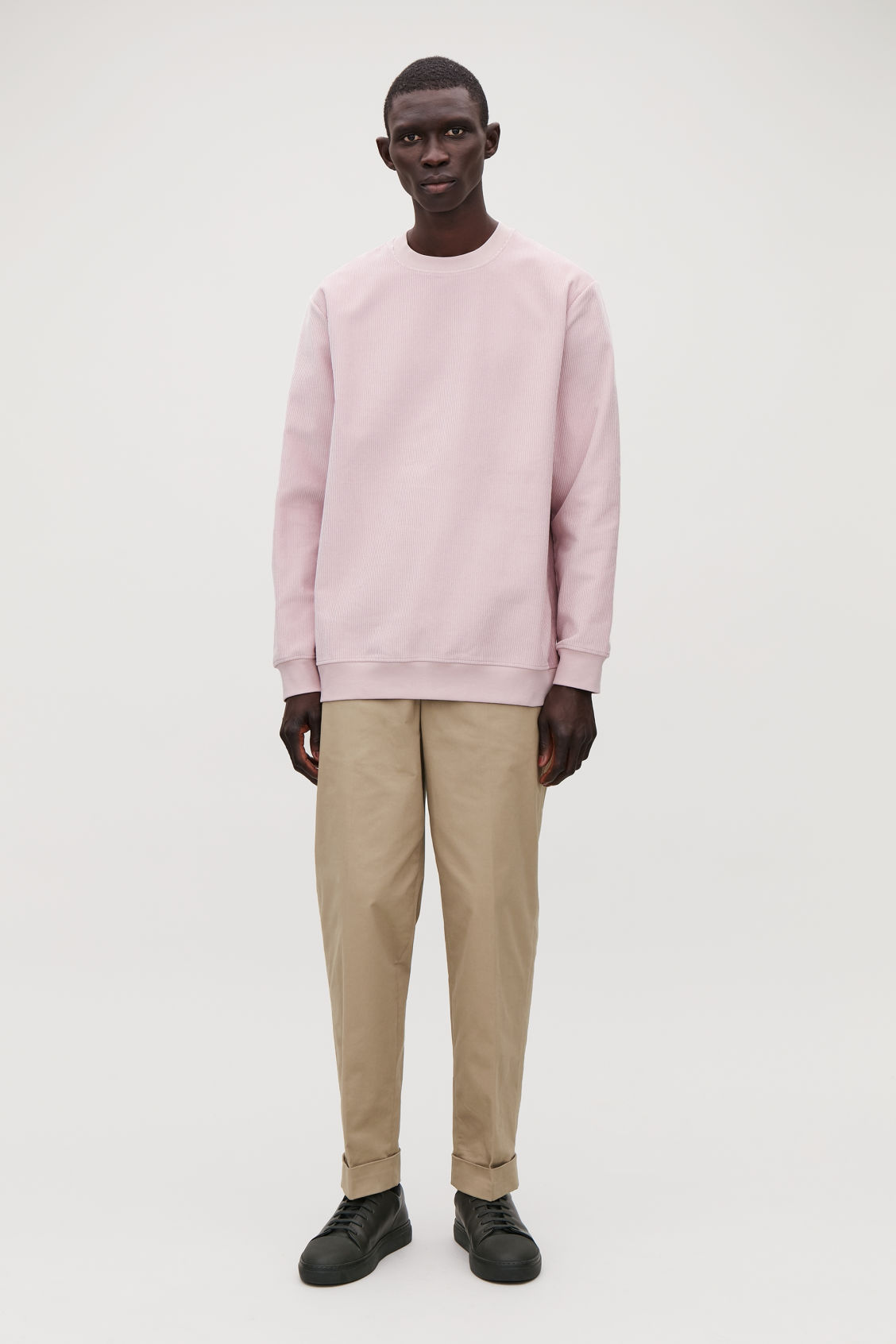 Model front image of Cos corduroy sweatshirt in pink