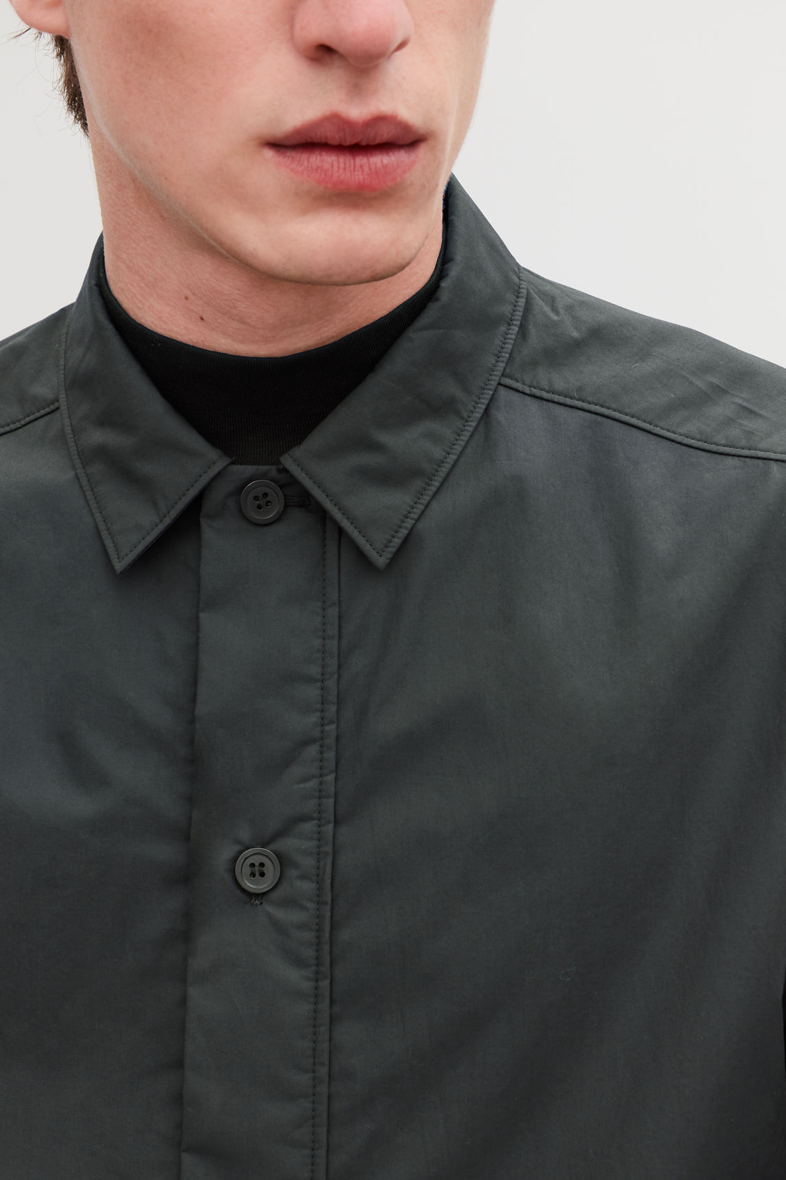 Model side image of Cos padded long-sleeved shirt in black