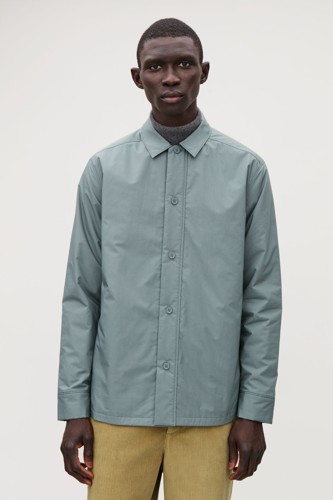 Model side image of Cos padded long-sleeved shirt in green