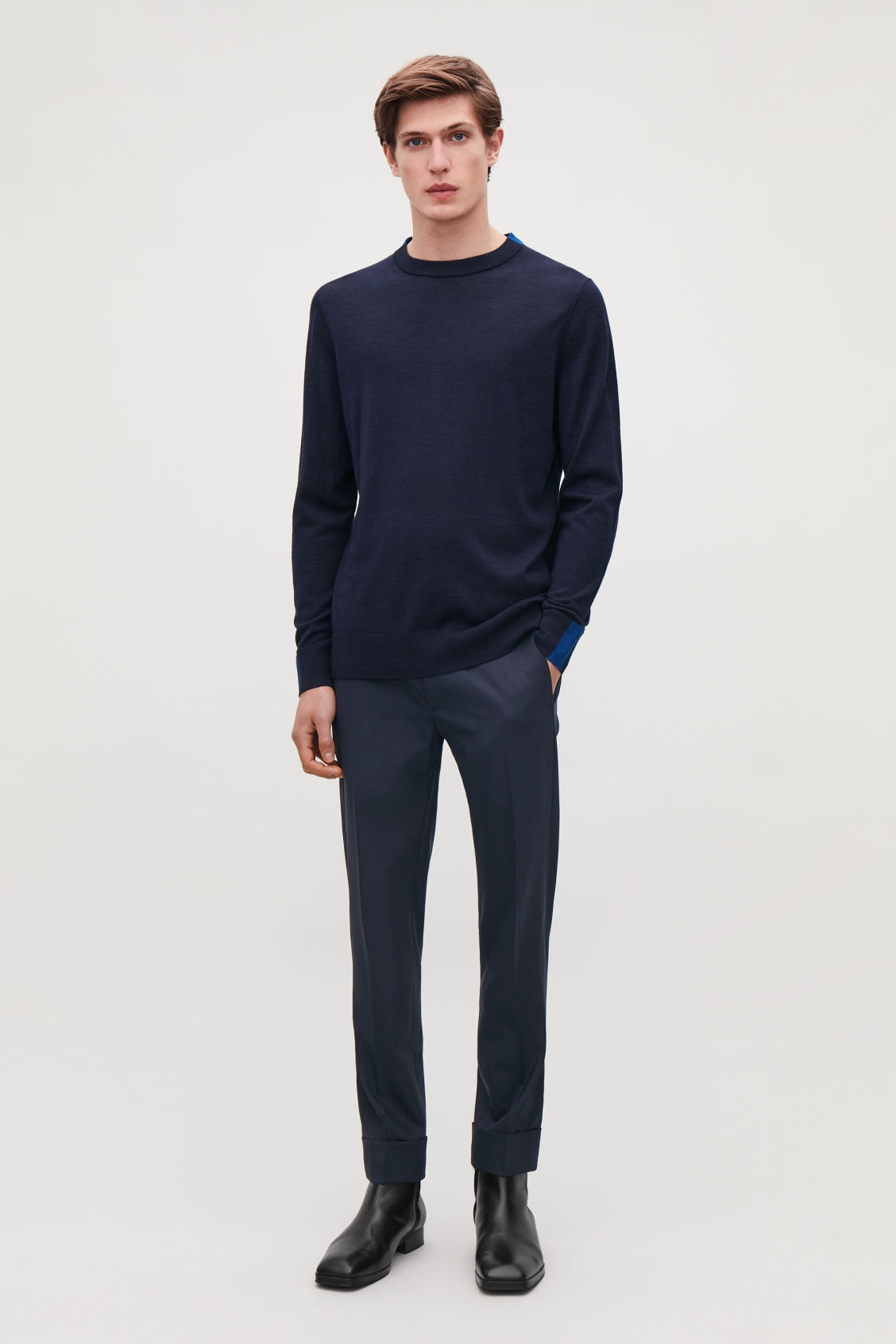 Model front image of Cos slim trousers with side panels in blue