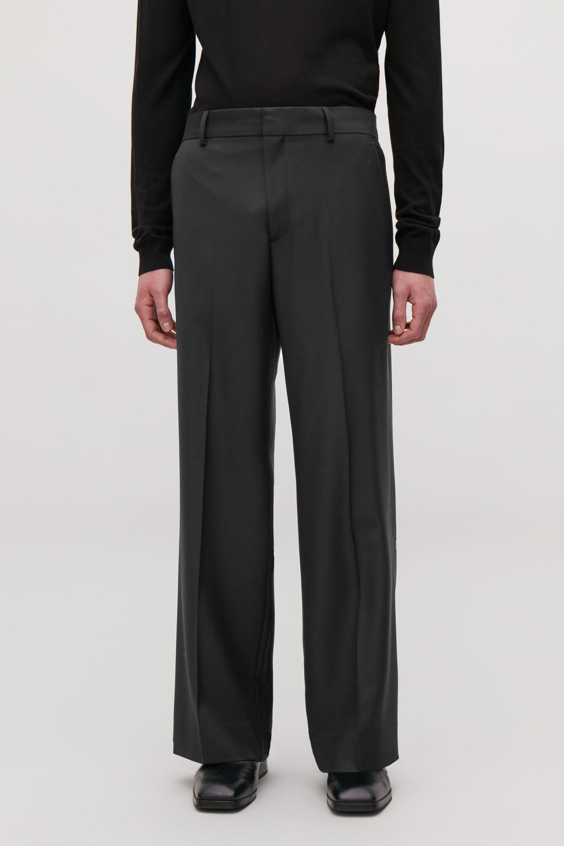 Model side image of Cos wide-leg trousers in black