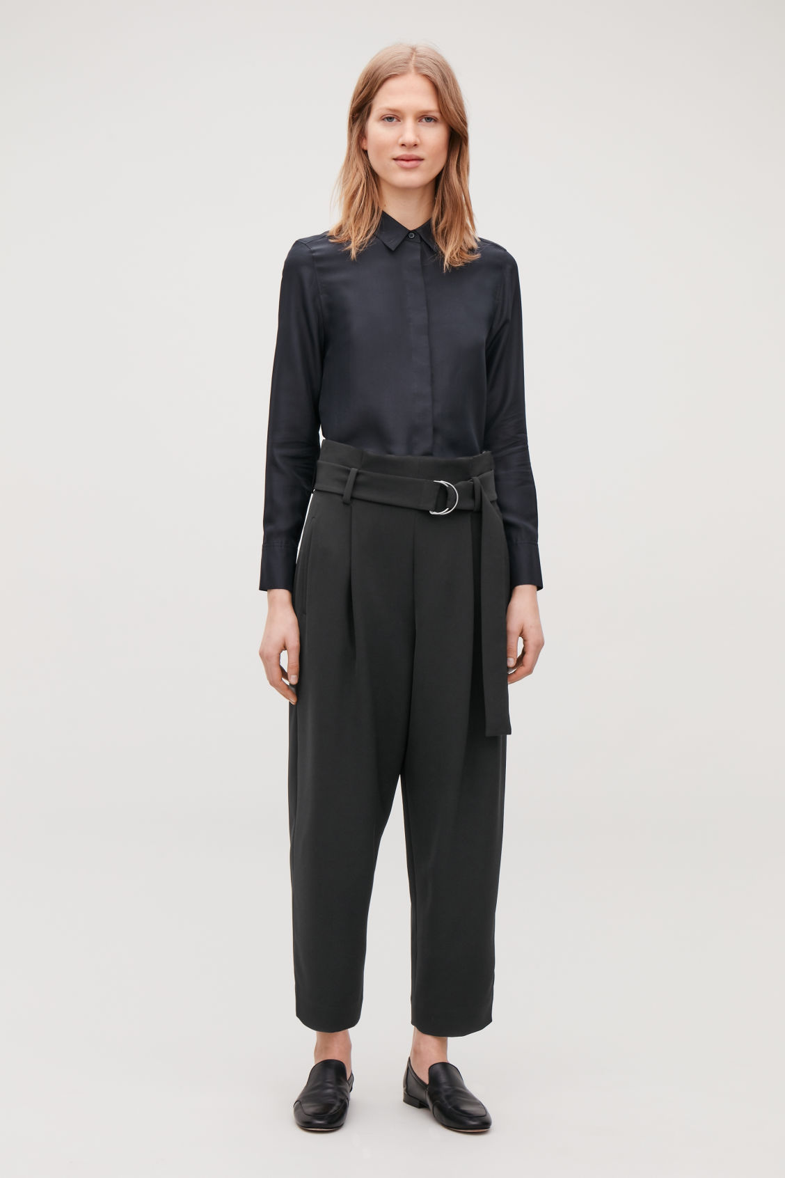 Model side image of Cos d-ring belted paperbag trousers in black