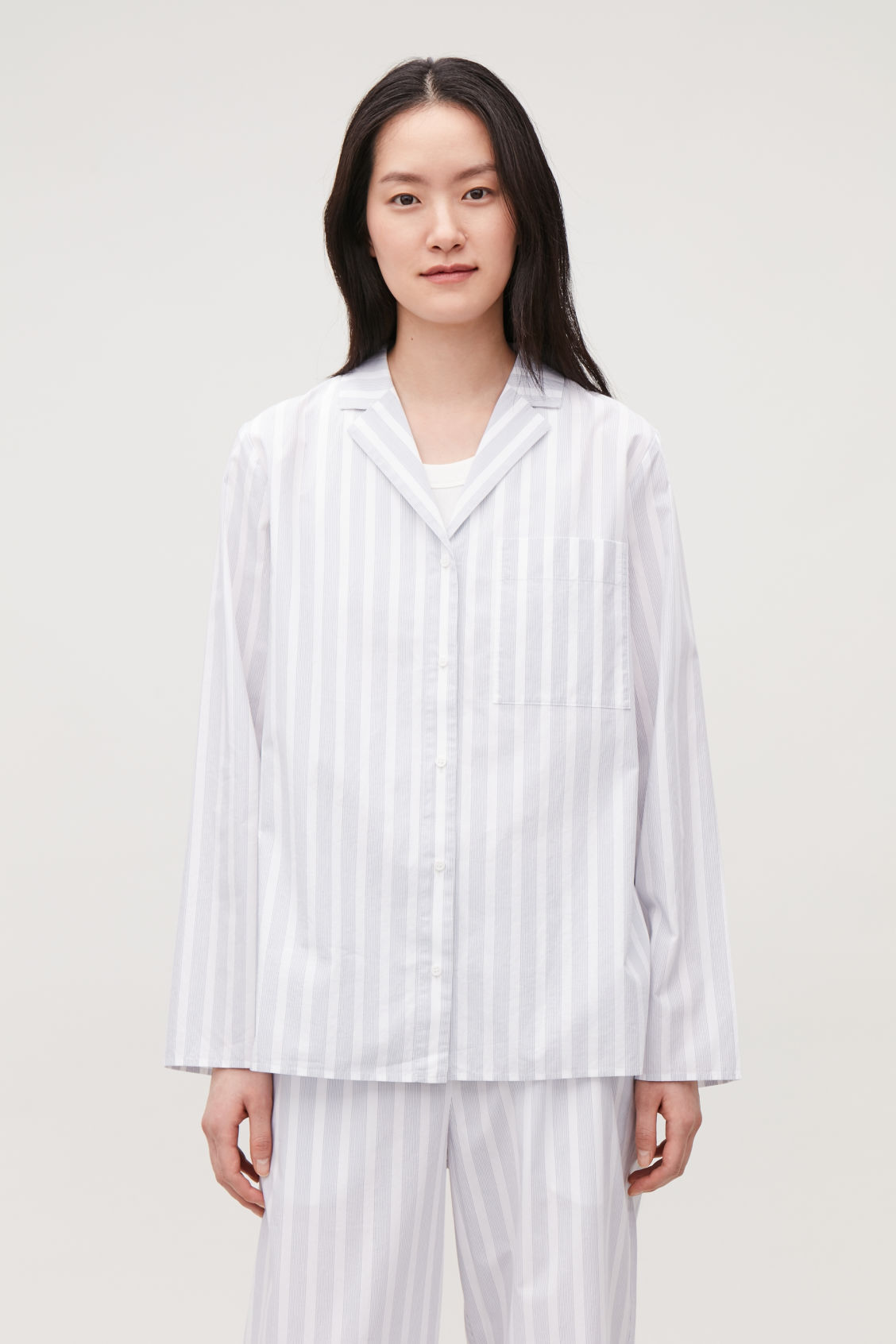 Model side image of Cos lapel-collar striped pyjama shirt in white