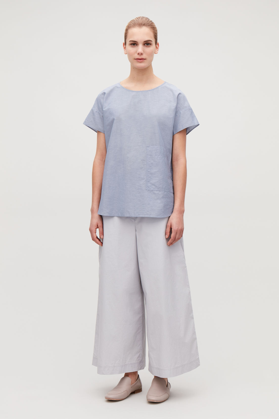 Model front image of Cos oversized cotton-linen top in blue