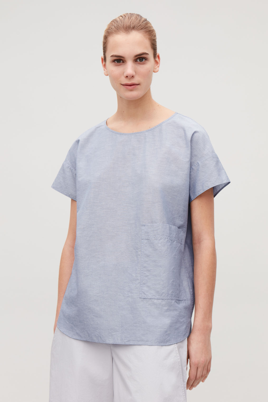 Model side image of Cos oversized cotton-linen top in blue