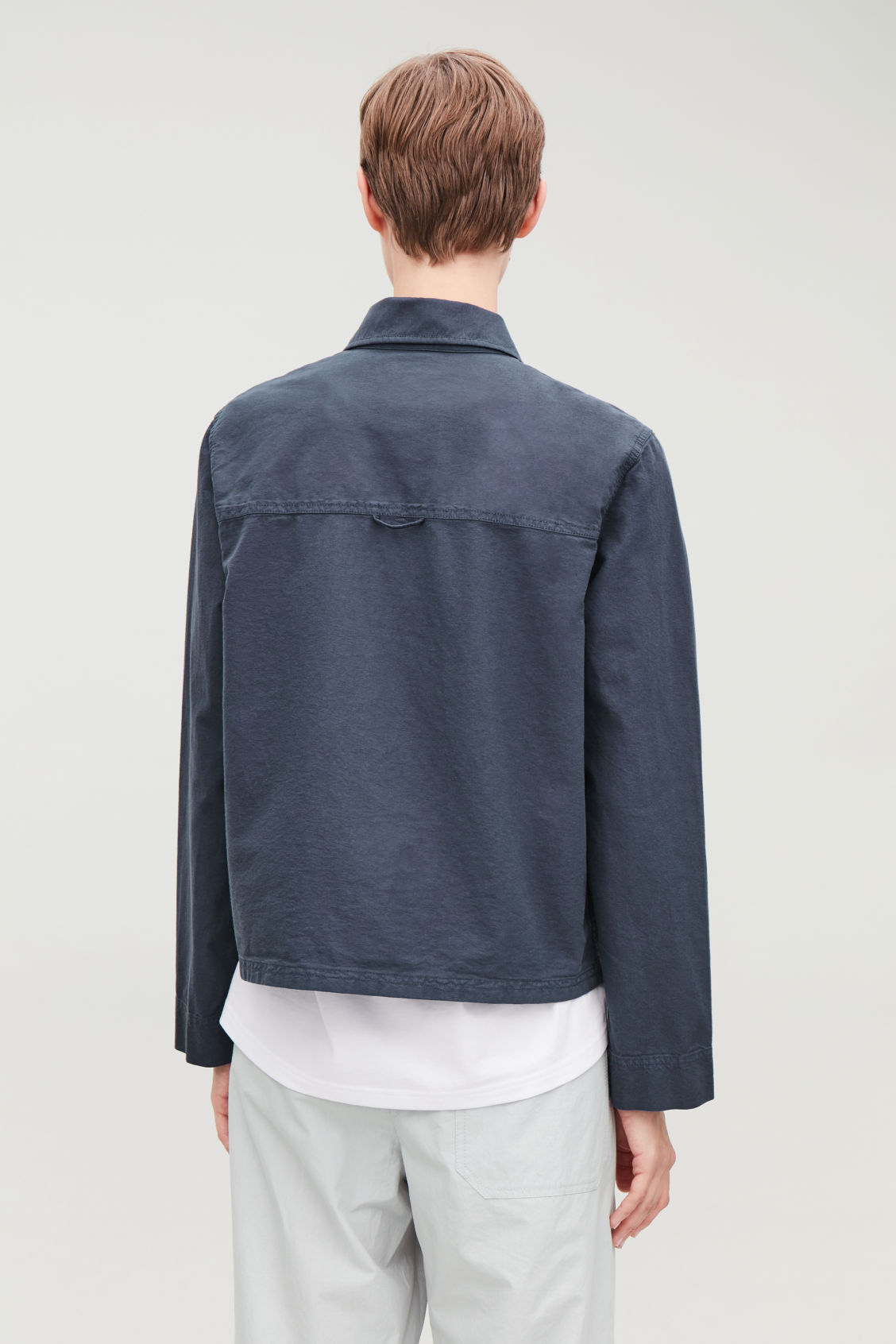 Model side image of Cos workwear shirt jacket  in blue