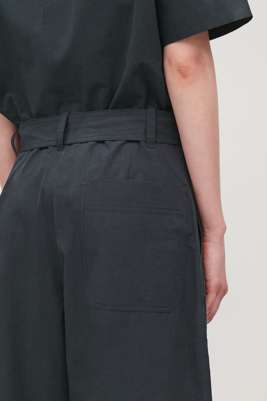 Model side image of Cos belted workwear jumpsuit  in black