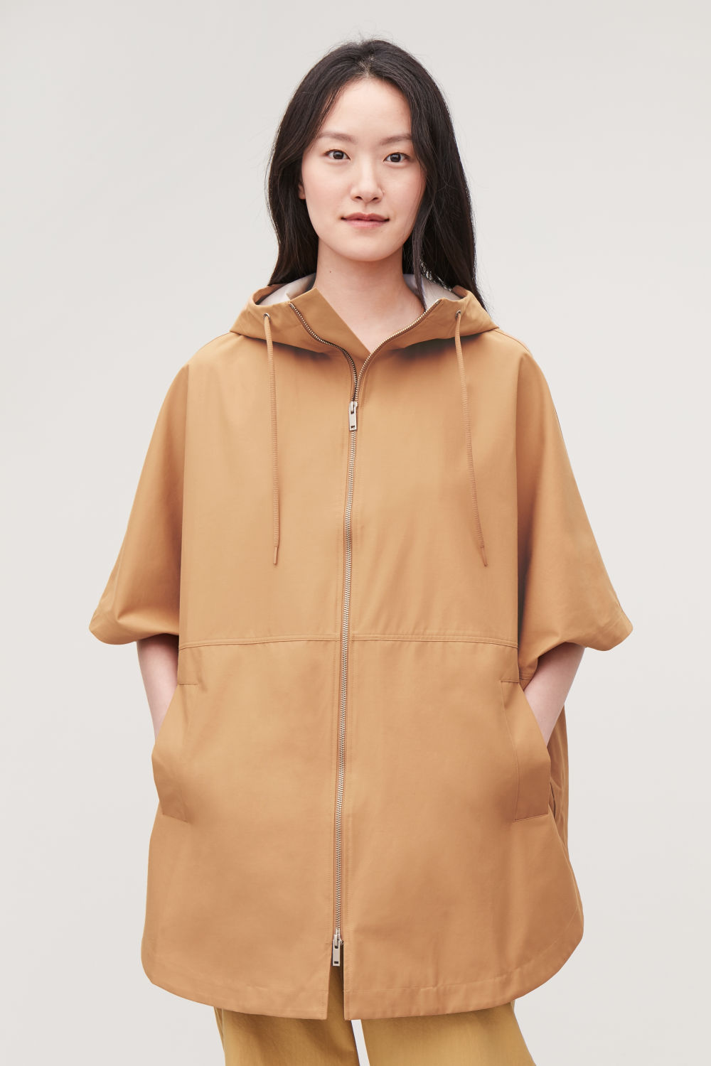 HOODED PONCHO WITH CURVED HEM