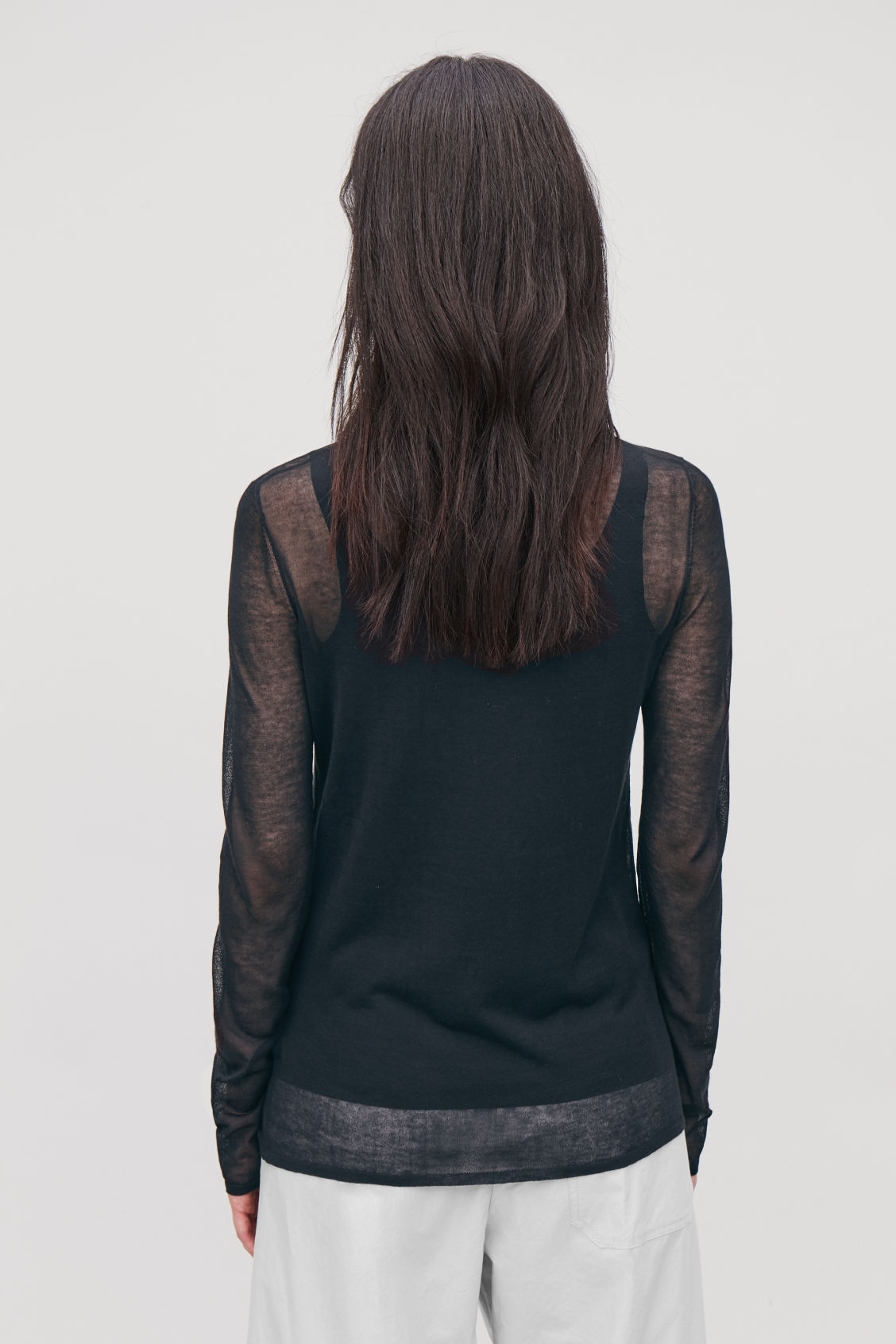 Model side image of Cos sheer slim-fit top in black