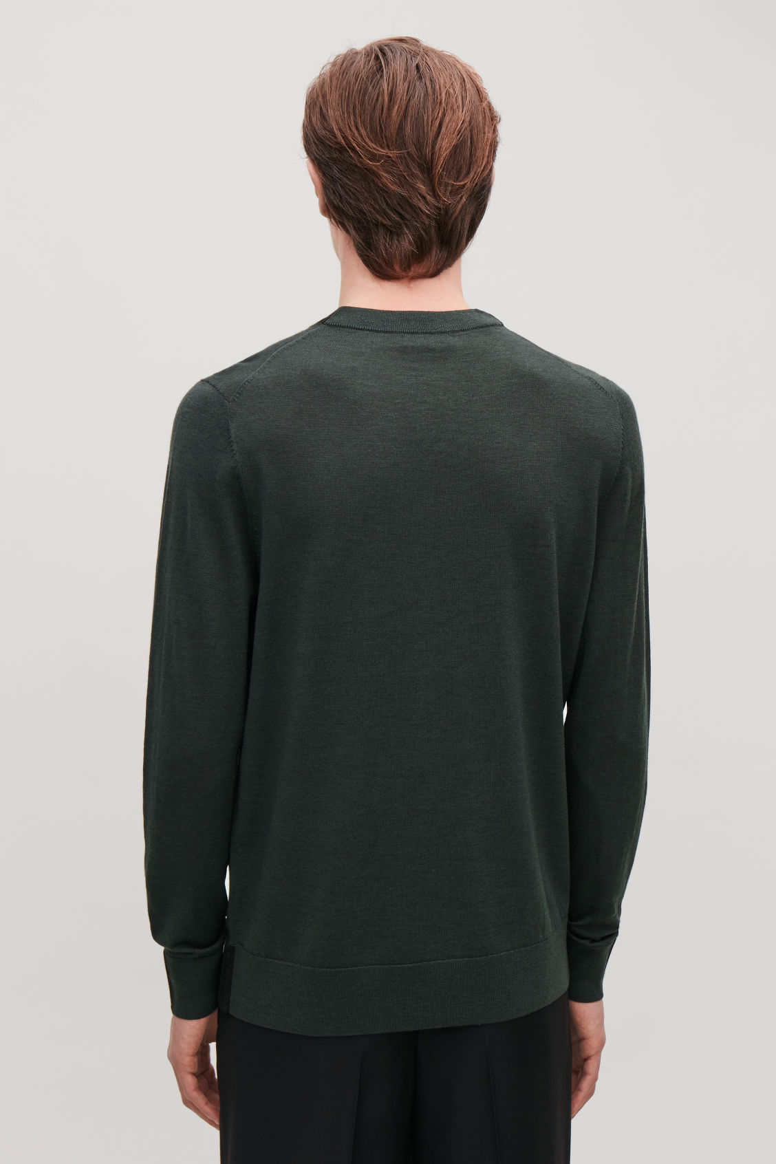 Model side image of Cos merino jumper with trim detail in green