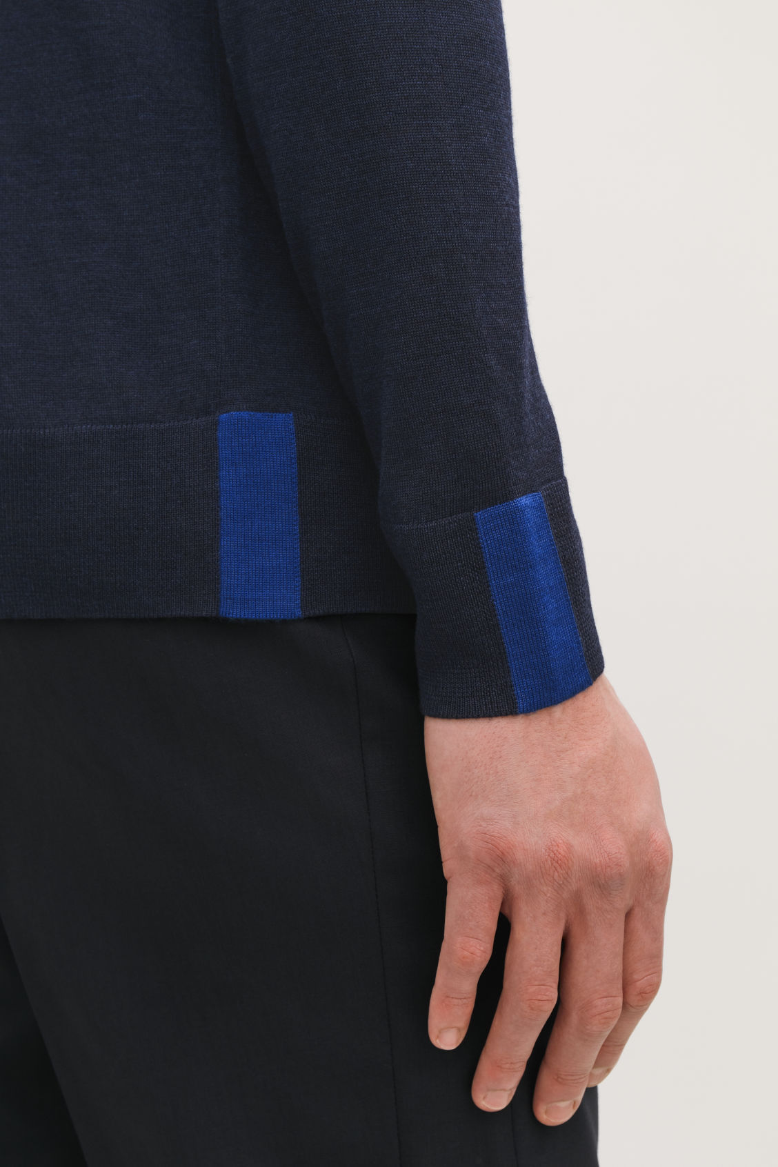 Model side image of Cos merino jumper with trim detail in blue