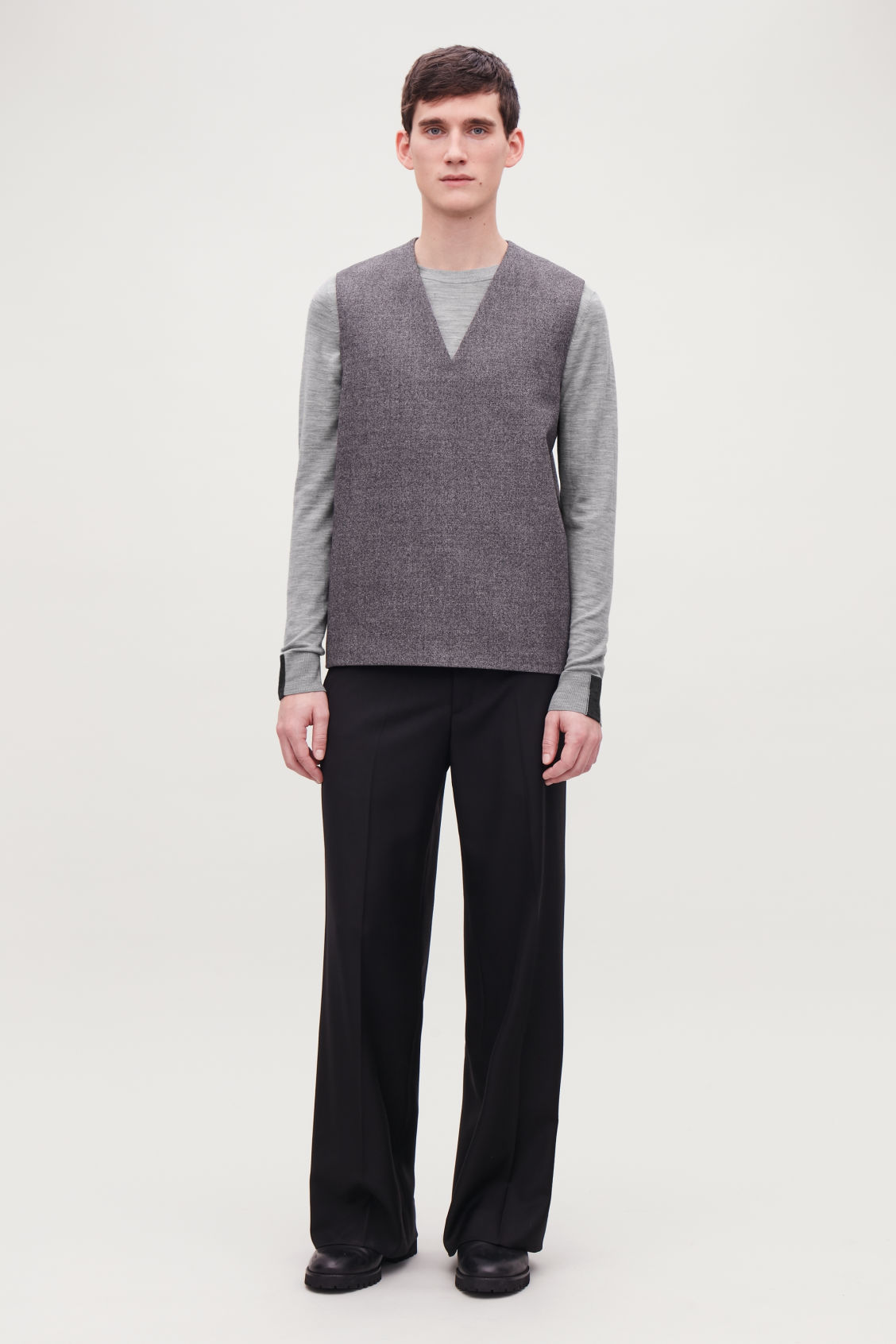 Model side image of Cos merino jumper with trim detail in grey