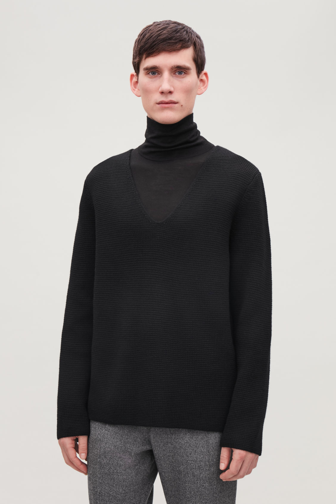 Model side image of Cos wool v-neck jumper  in black