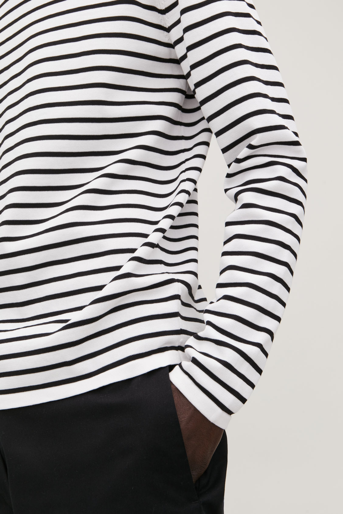 Model side image of Cos striped cotton crew-neck jumper in white