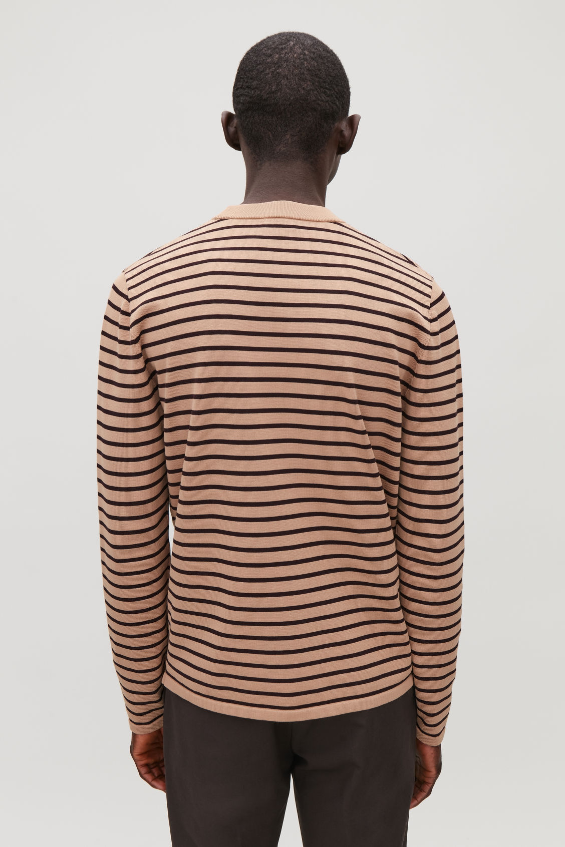 Model side image of Cos striped cotton crew-neck jumper in orange