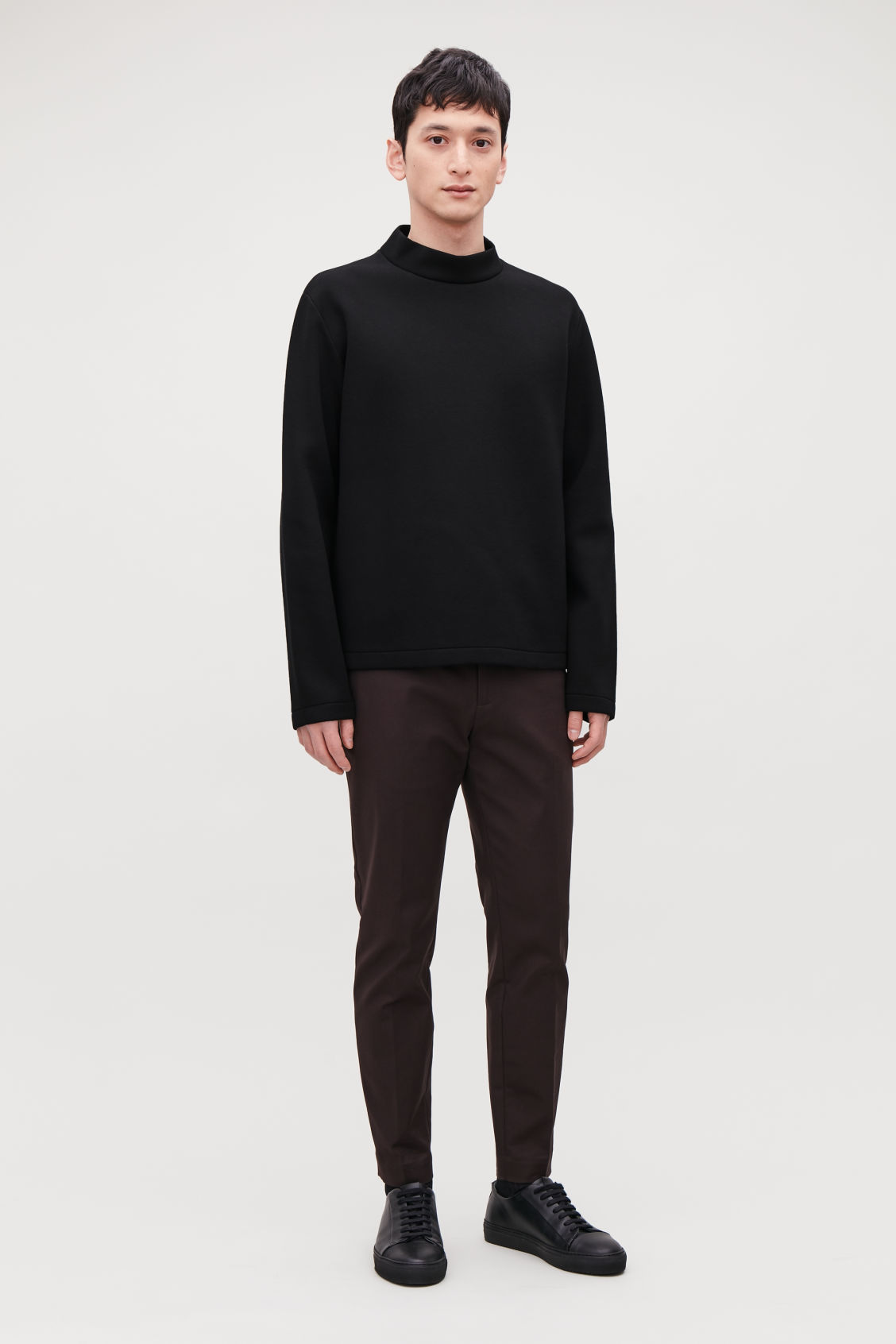 Model front image of Cos funnel-neck scuba sweatshirt in black