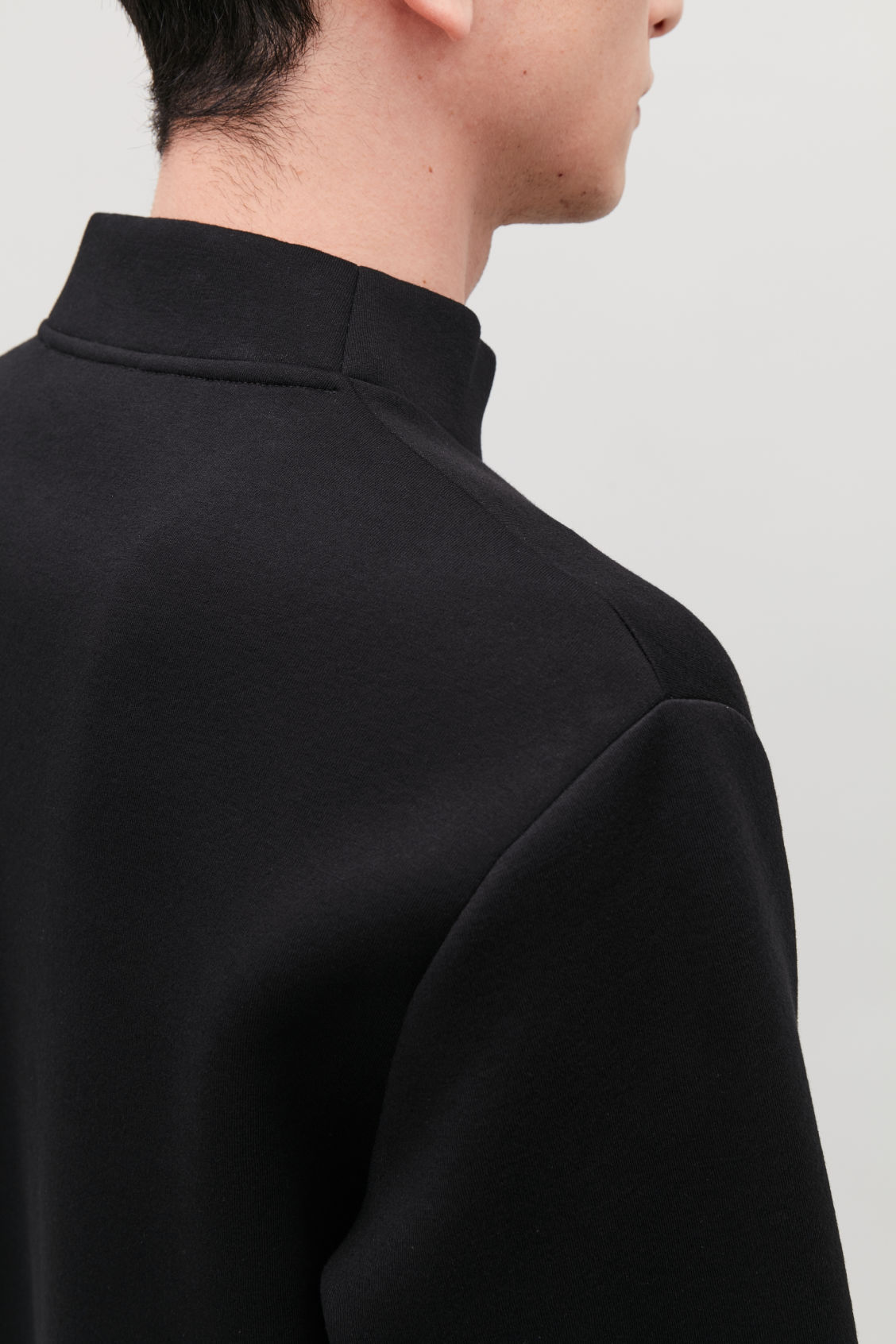 Model side image of Cos funnel-neck scuba sweatshirt in black
