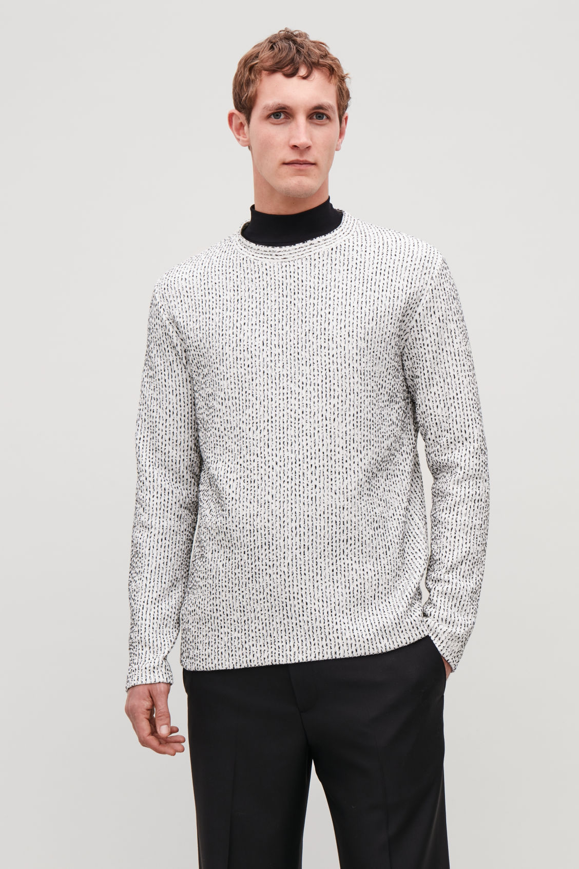Model side image of Cos ribbed long-sleeved t-shirt in white