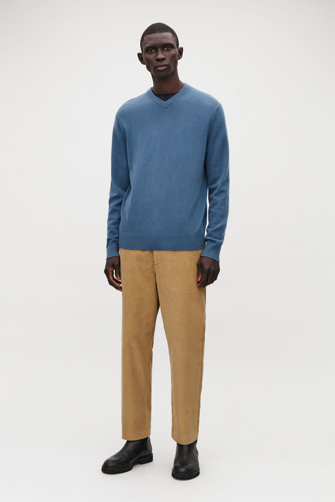 Model side image of Cos high v-neck cashmere jumper in blue