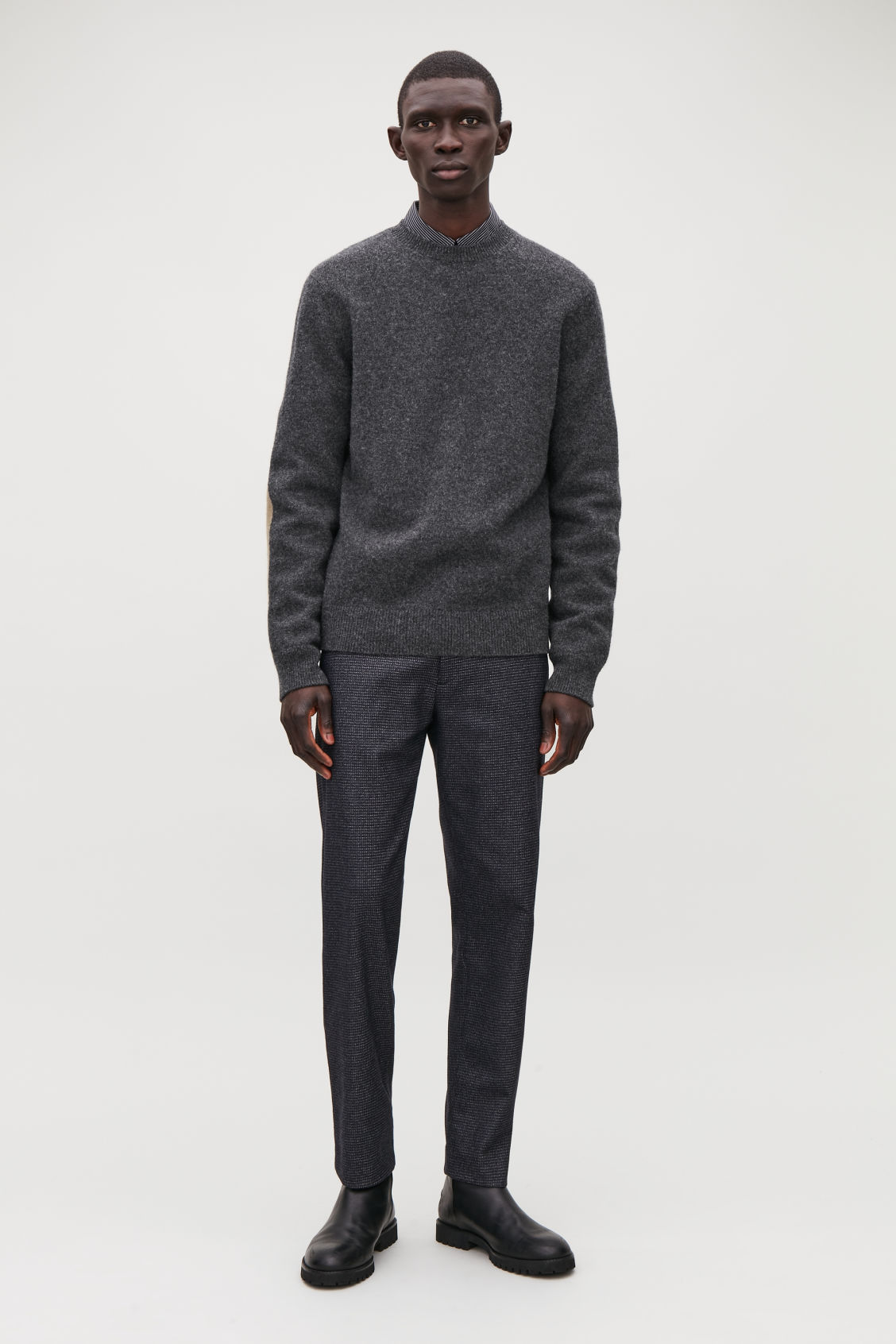 Model front image of Cos lambswool jumper with elbow patches in black