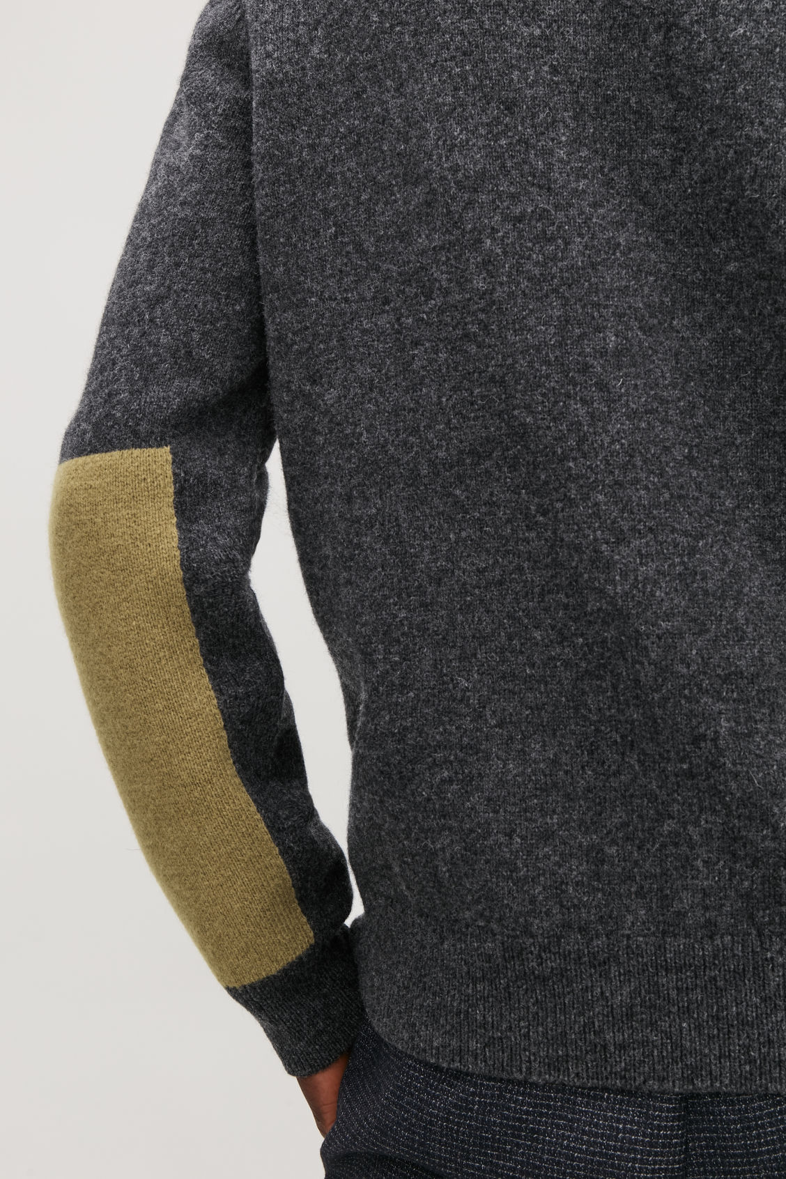 Model side image of Cos lambswool jumper with elbow patches in black