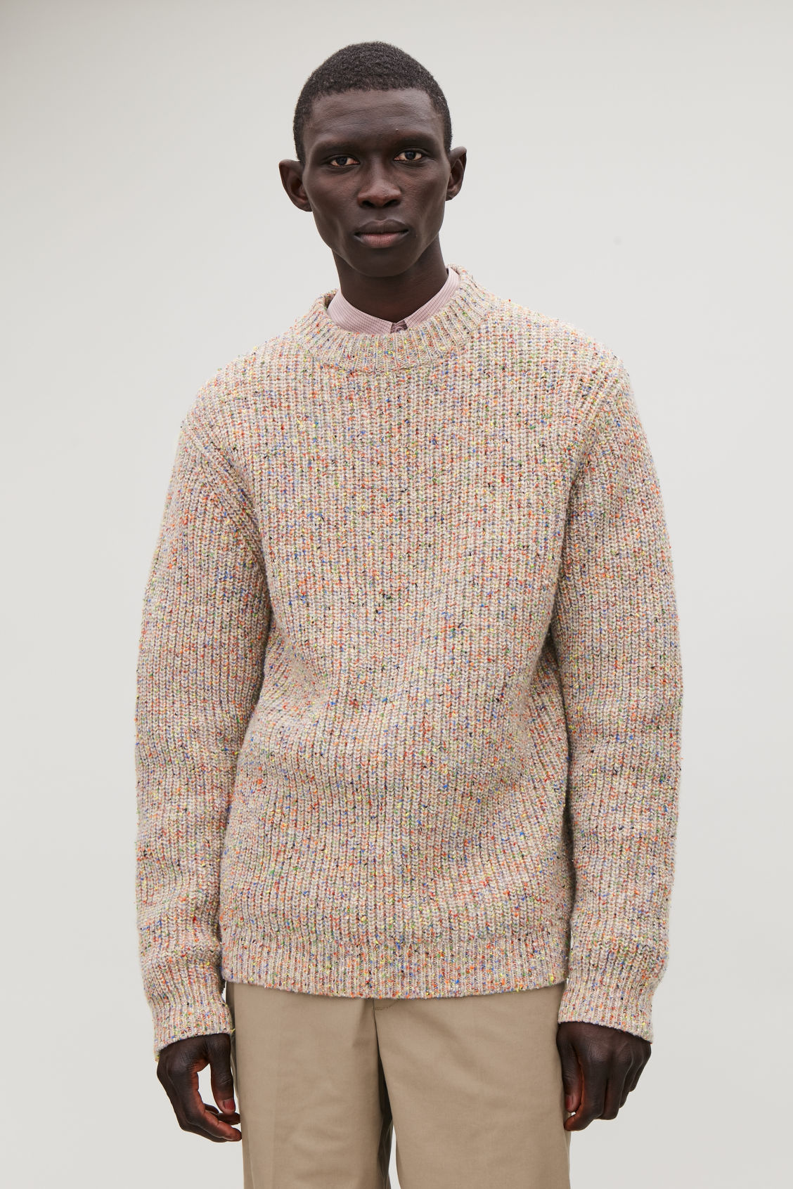 Model side image of Cos speckled chunky-knit jumper in brown