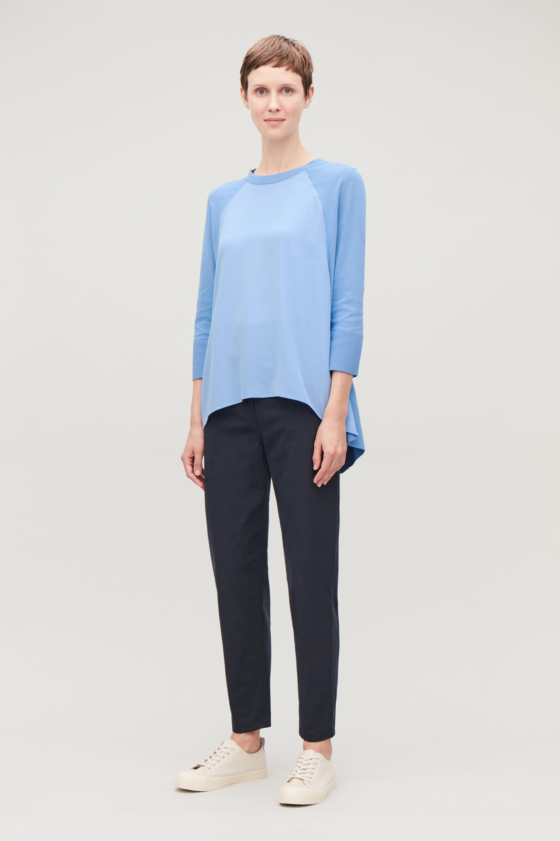 Model front image of Cos silk-front a-line knit top in blue