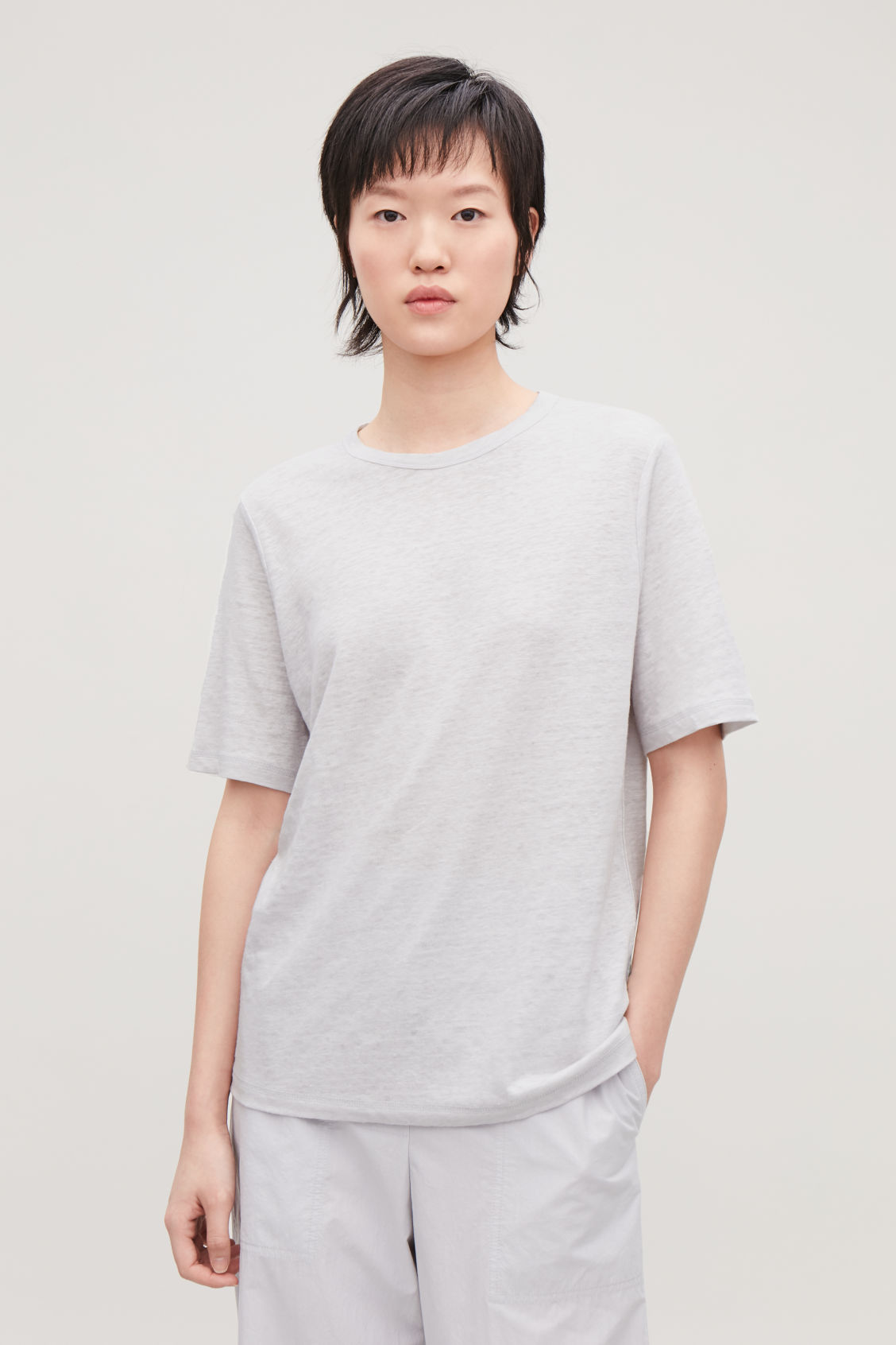 Model side image of Cos boxy linen t-shirt in grey