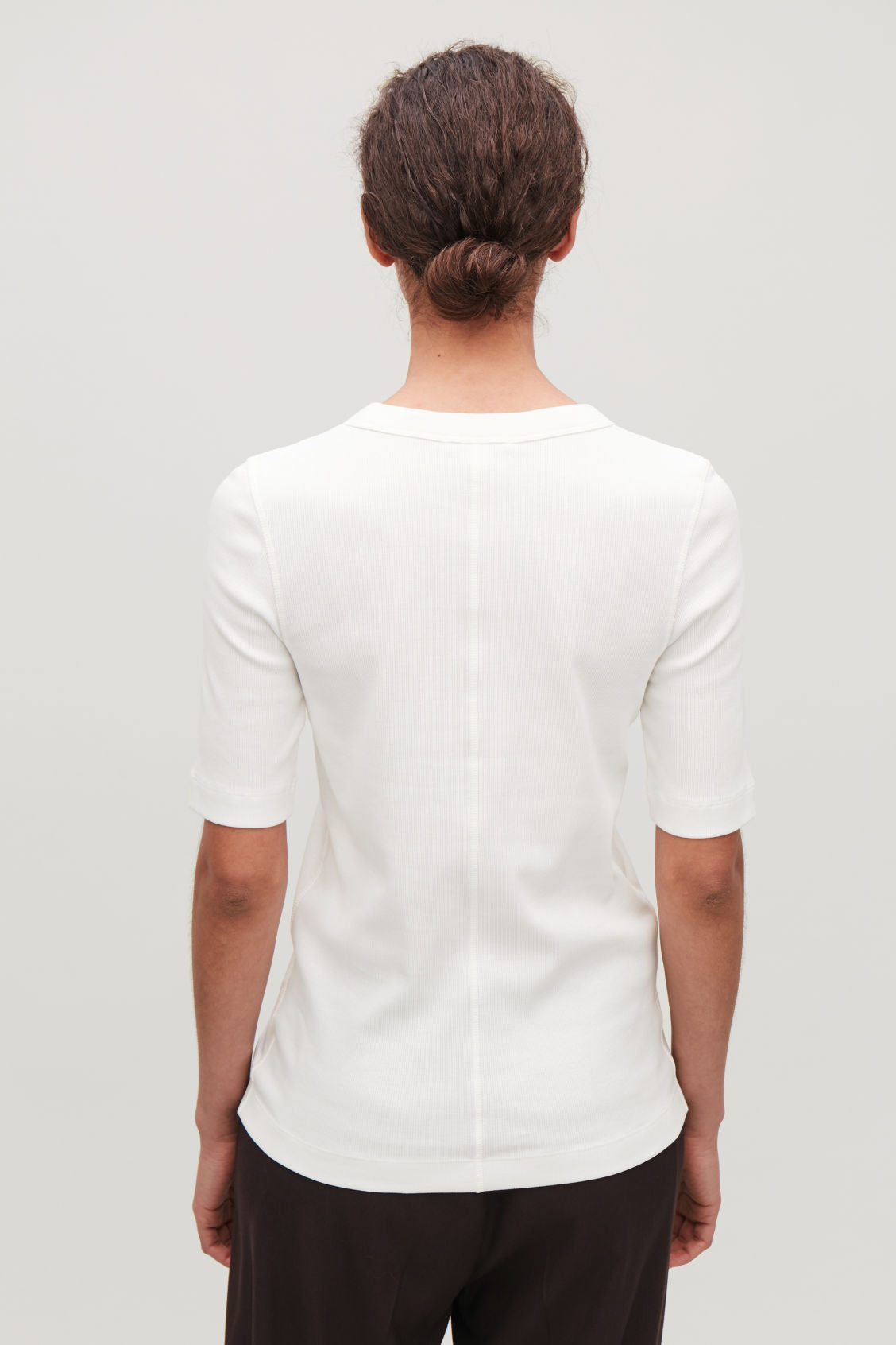 Model side image of Cos ribbed jersey t-shirt  in white