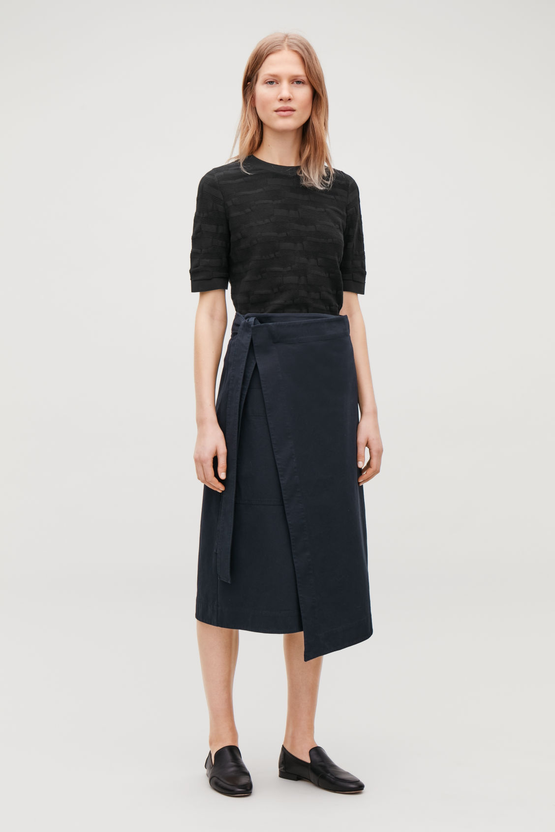 Model front image of Cos irregular-stitch knit top in black