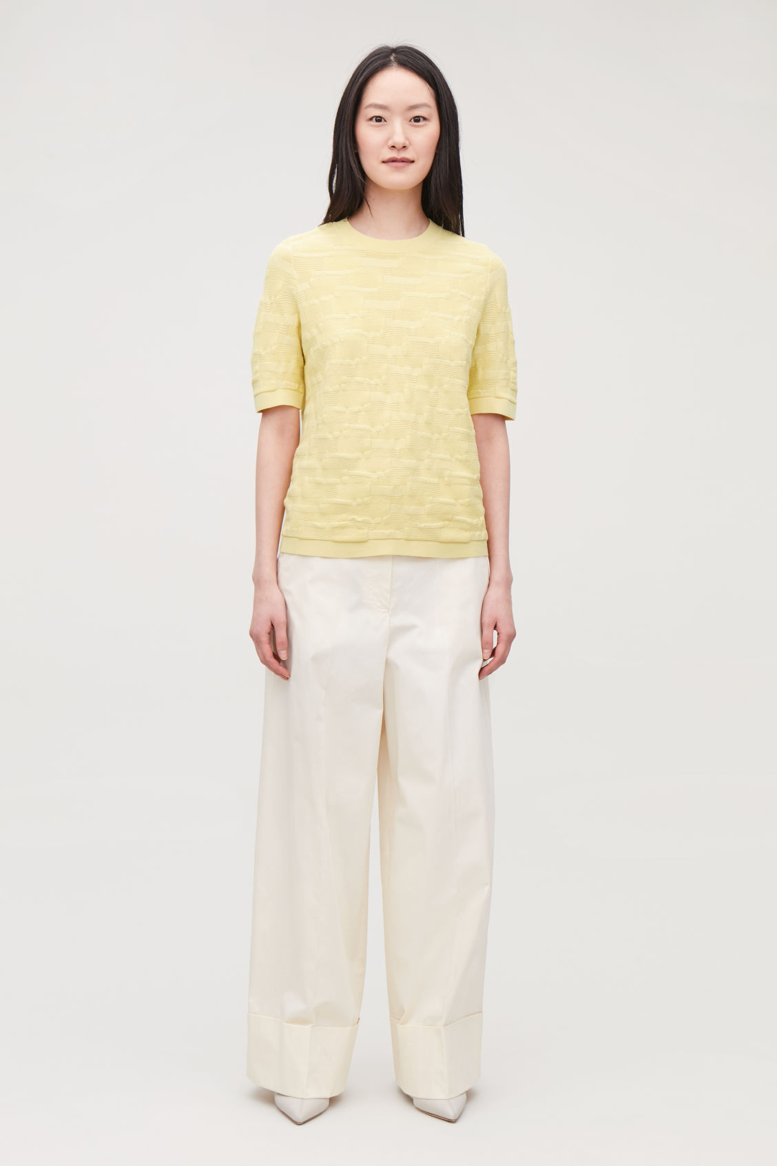 Model front image of Cos irregular-stitch knit top in yellow