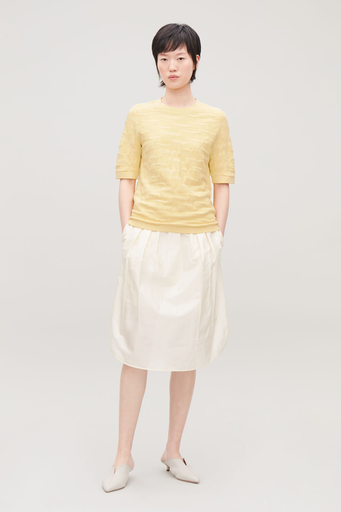 Model side image of Cos irregular-stitch knit top in yellow