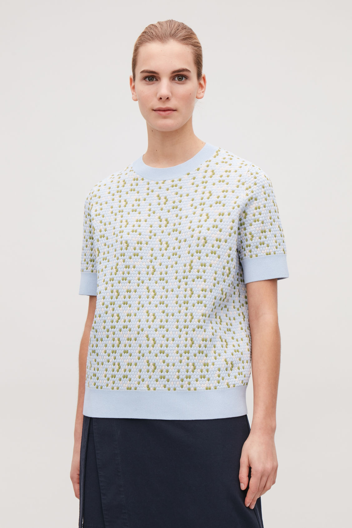 Model side image of Cos special-stitch cotton-knit top in blue