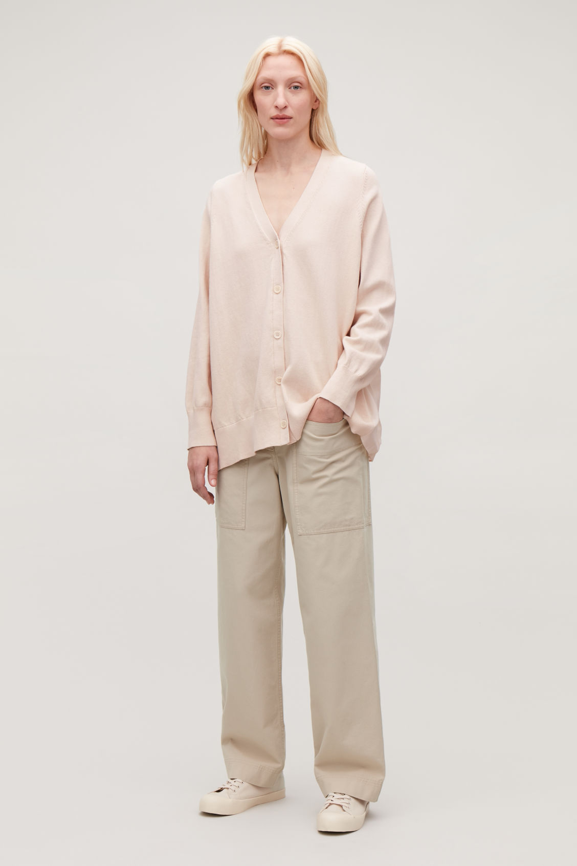 Model front image of Cos pleated-panelled cardigan in beige