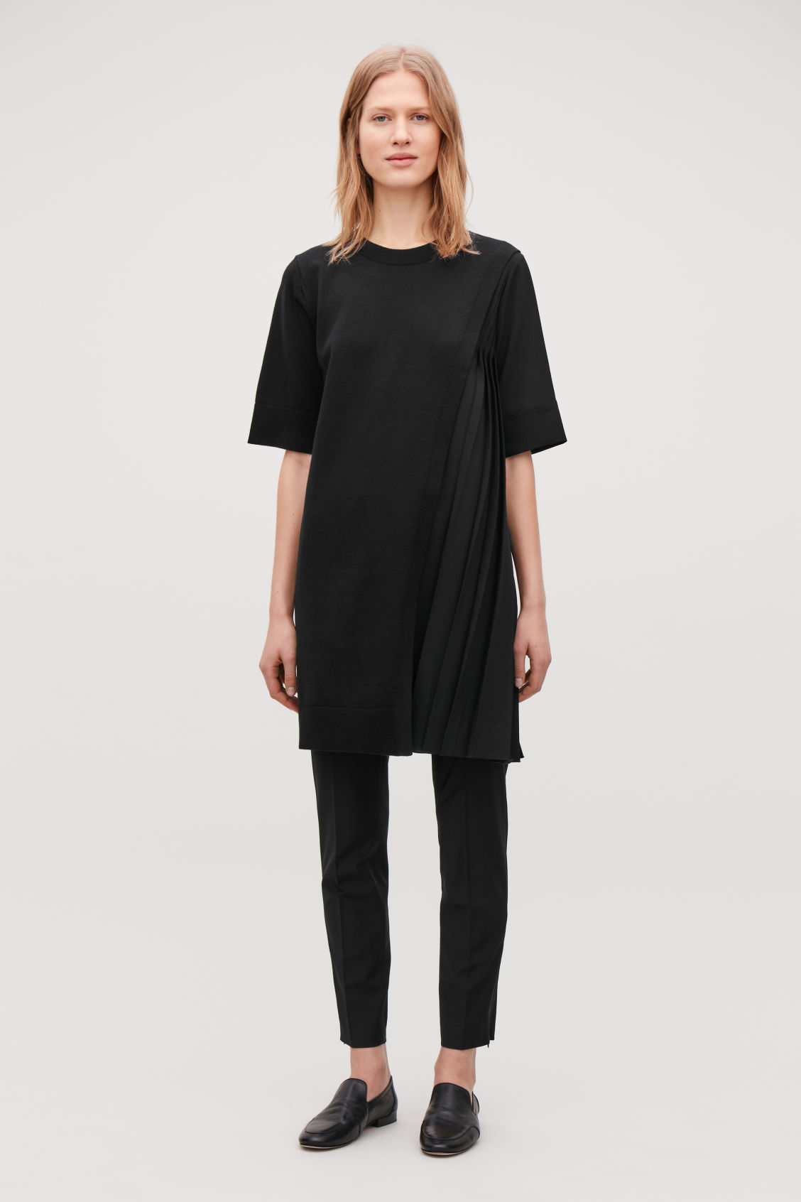 Model front image of Cos pleated-panelled knit dress in black