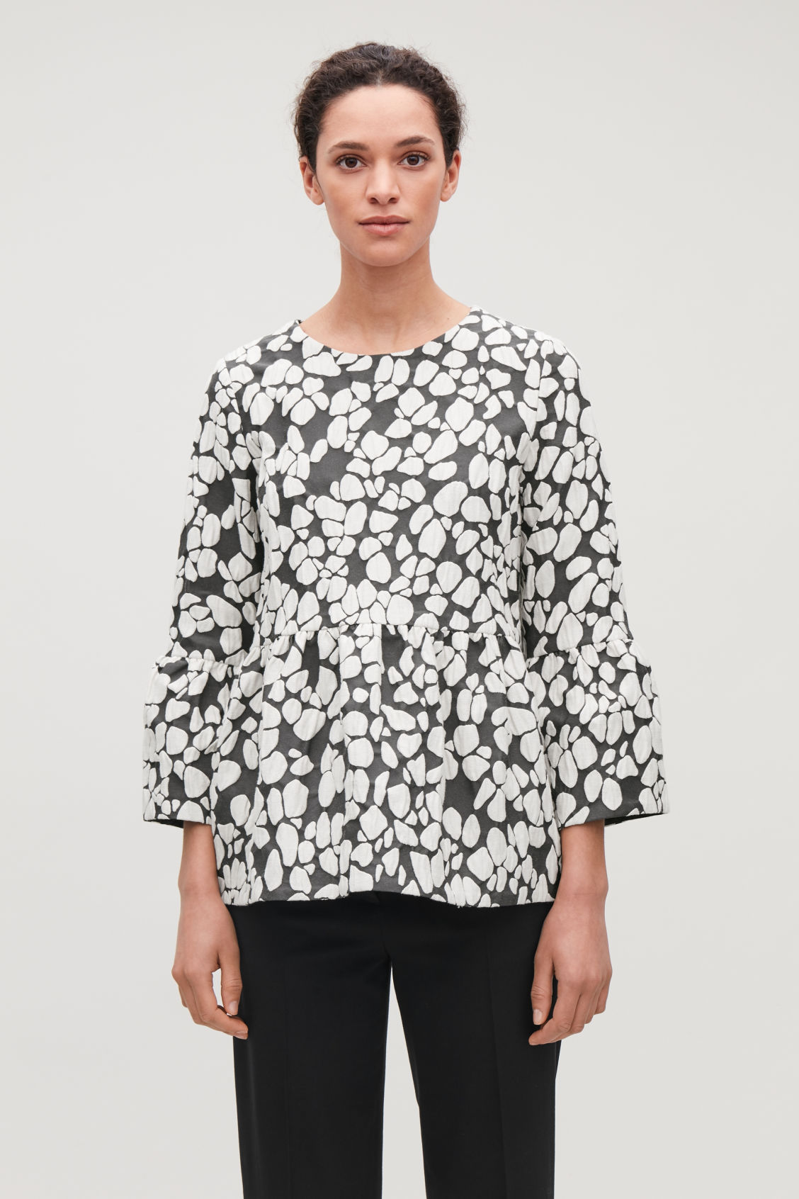 Model side image of Cos gathered jacquard a-line top in grey