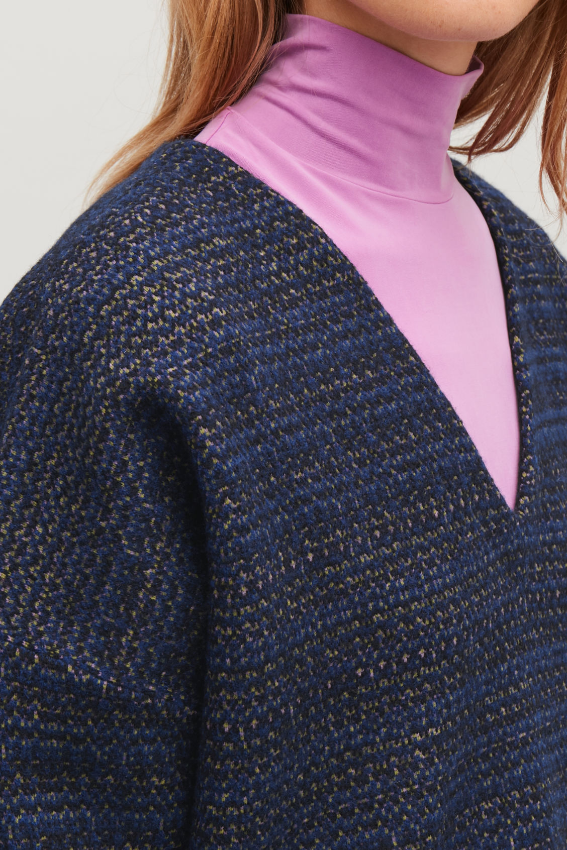 Model side image of Cos jacquard boiled-wool jumper in blue