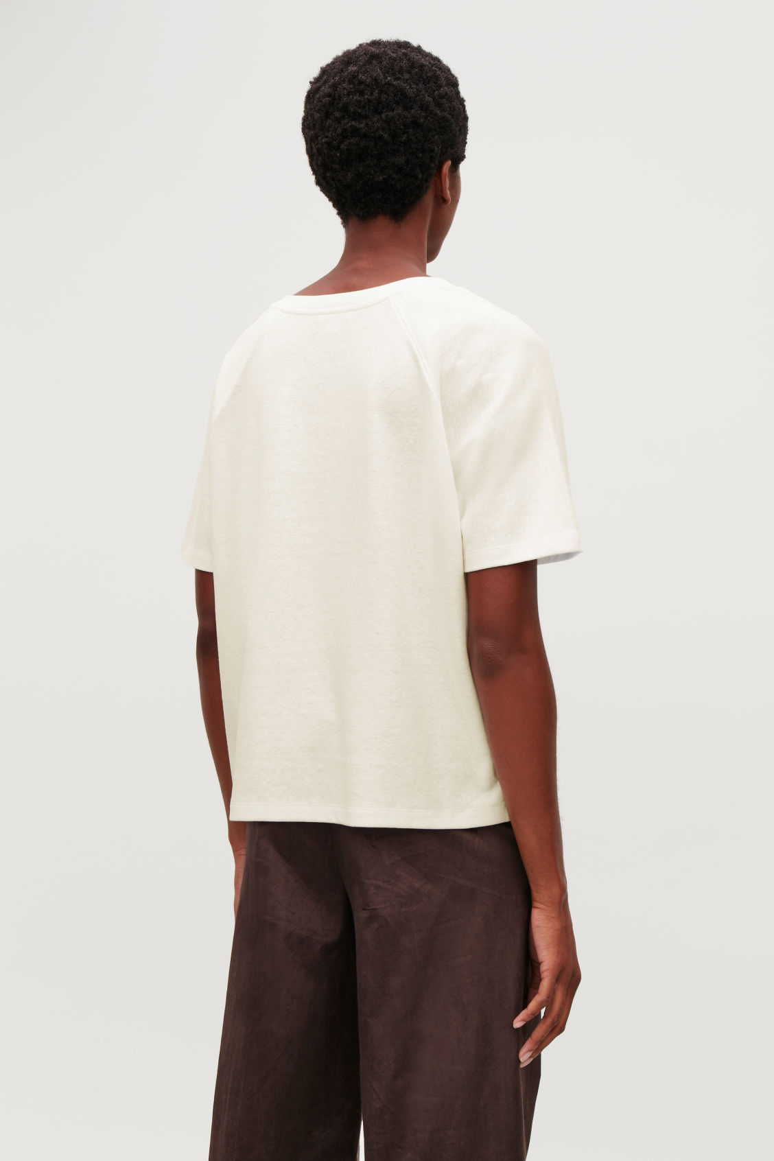 Model side image of Cos raglan-sleeved t-shirt in neutral
