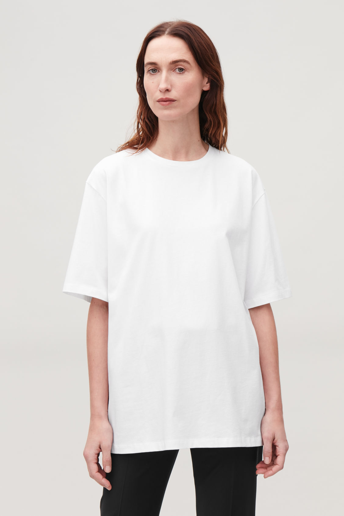 Model side image of Cos oversized round-neck t-shirt  in white