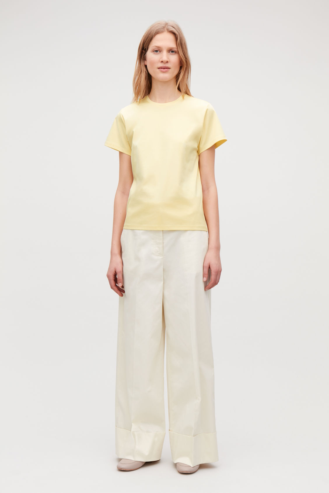 Model front image of Cos round-neck jersey t-shirt in yellow