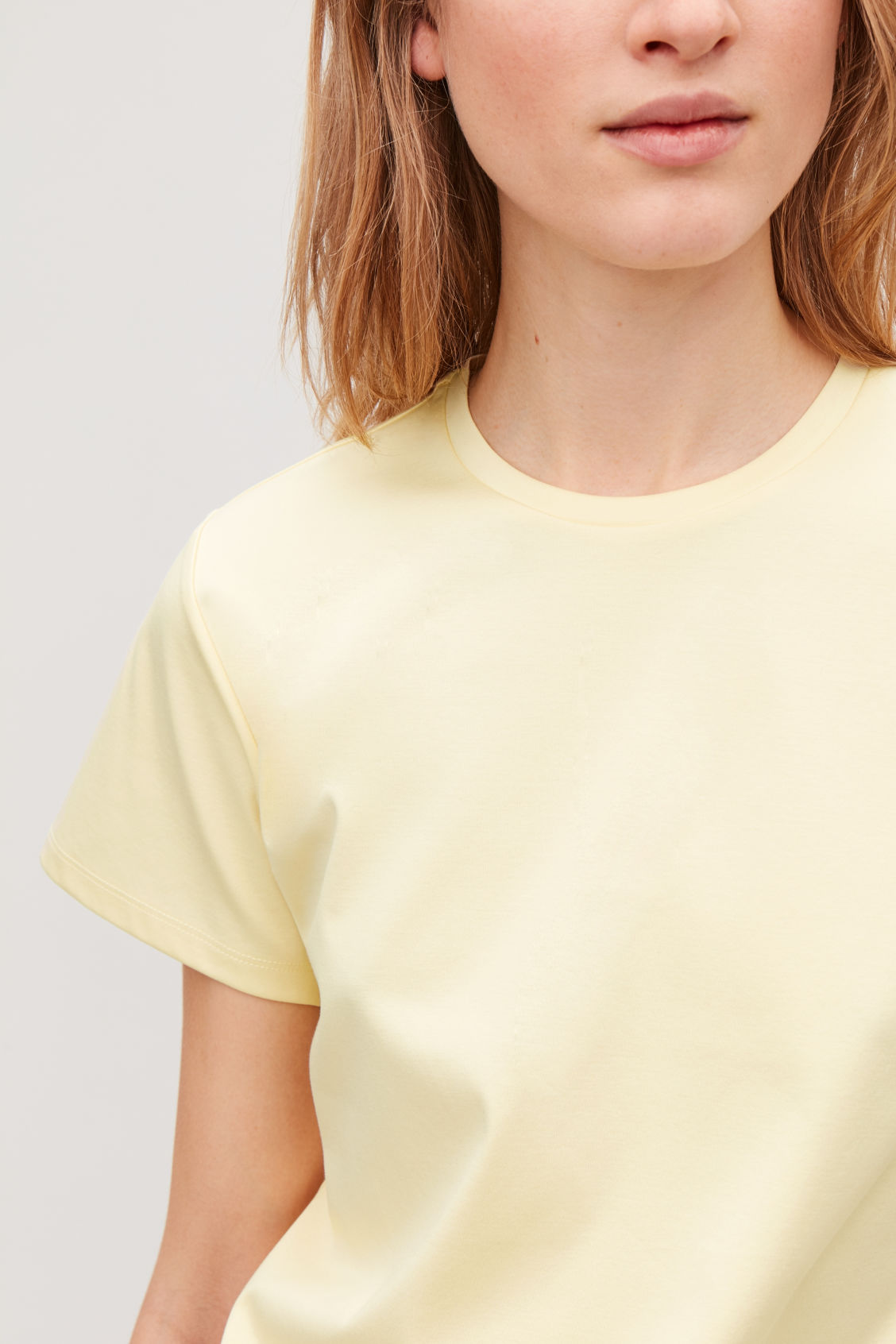 Model side image of Cos round-neck jersey t-shirt in yellow