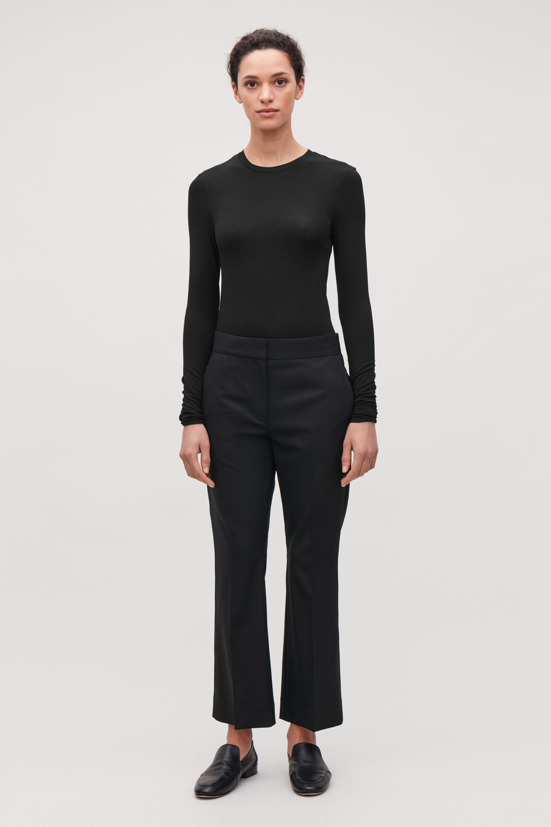 Model front image of Cos slim-fit jersey top in black