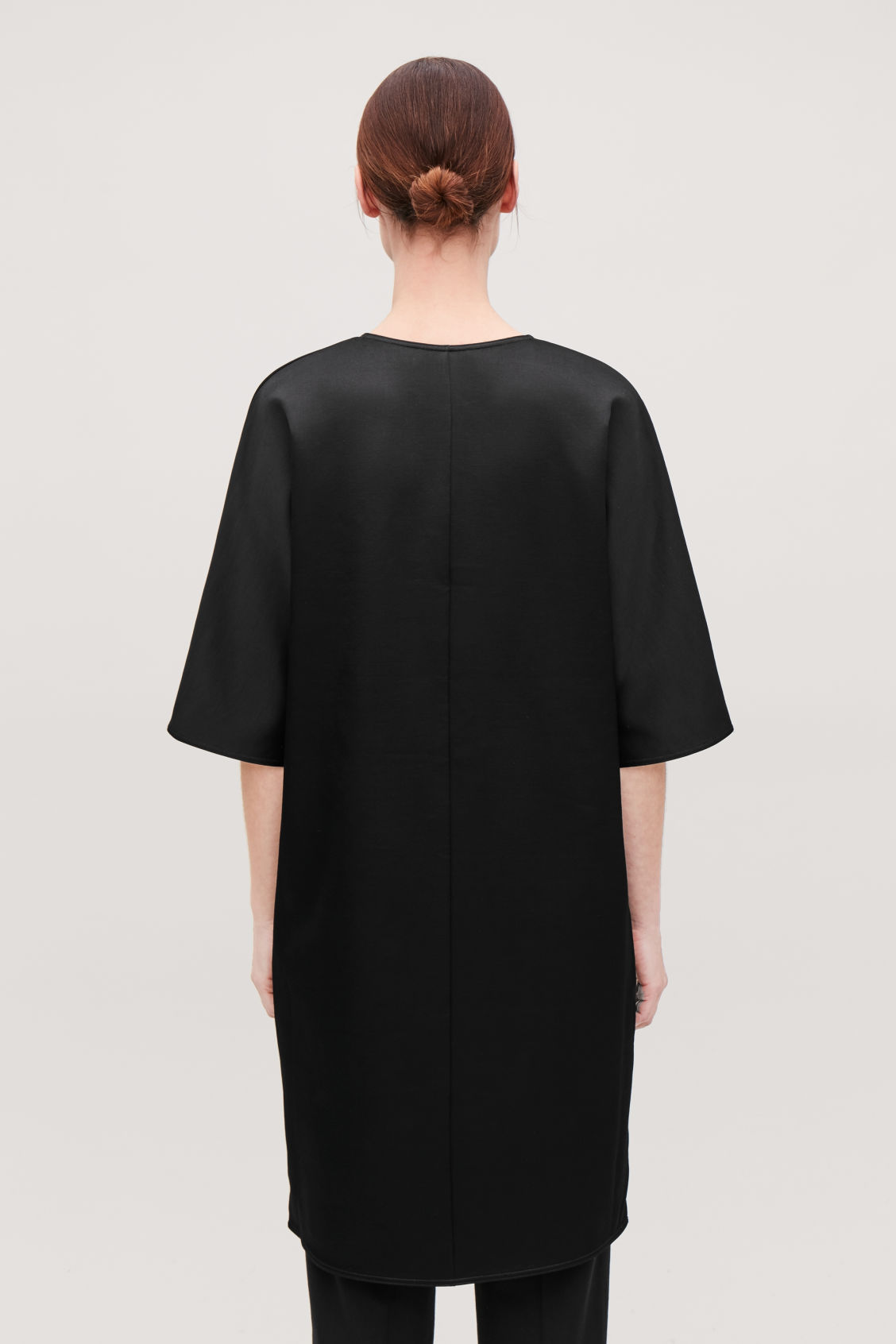 Model side image of Cos batwing-sleeved jersey dress  in black